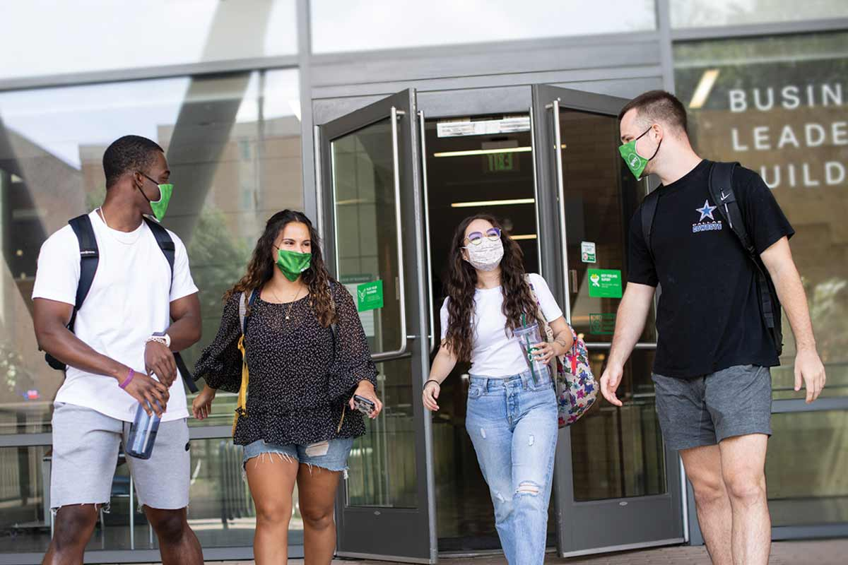 UNT students walking out of the Business Leadership Building